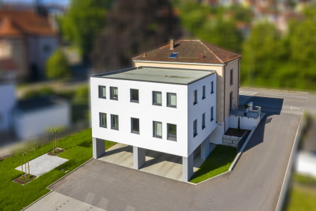 rebau-Referenzprojekte - Umbau und Modernisieren - Anbau Bürogebäude mit PKW-Stellplatz